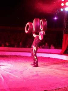 Hercules juggles tyres.