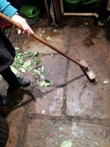 Helen sweeps the old York flagstones that were once part of the outside pathway around 60 Upper Street.