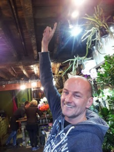 Marco Wouters points at the burnt beams in the ceiling of his business Angel Flowers.