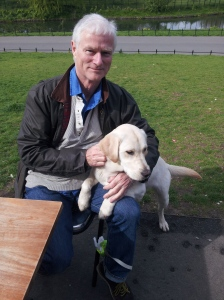 Tim Bushe with his trainee guide dog puppy, Renee.