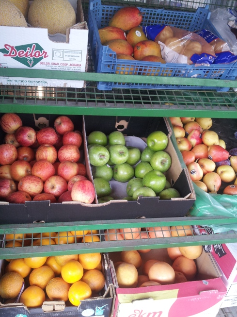 Racks of fruit.  Spot mangoes, apples and melon all stocked by Arsenal Food & Wine on Gillespie Road.