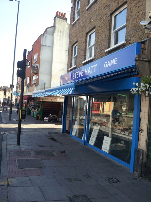 Steve Hatt fishmongers: a rare view without a queue emerging on to Essex Road.
