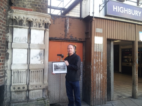 The original pillar from the old Highbury station is on the left of today's entrance. I was lucky and got Christopher Curtis to show me it using one of his photos as a prop.