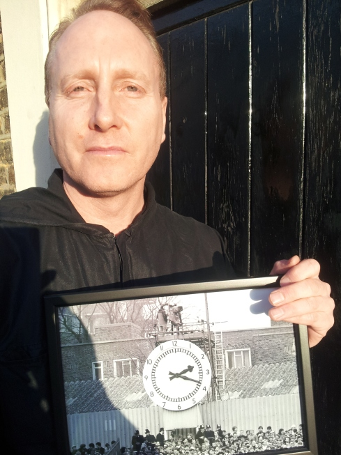 Christopher Curtis: local history photo and print seller - here with the old stand at Highbury's clock.