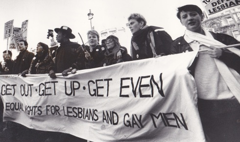 Charlie Kiss (far right) at a lesbian and gay protest march in the late '80s. Photo credit 'Paul Mattsson'. SPELLING? I left home at 16 and before getting involved with the anti-nuclear protest at Greenham Common, I immersed myself in the lesbian scene in London (long before I transitioned to male obviously).