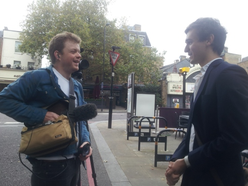 Oxfam staff interviewing signatories outside their I'm On Board campaign bus parked by Islington Green (Oct 2015). (c) islington faces