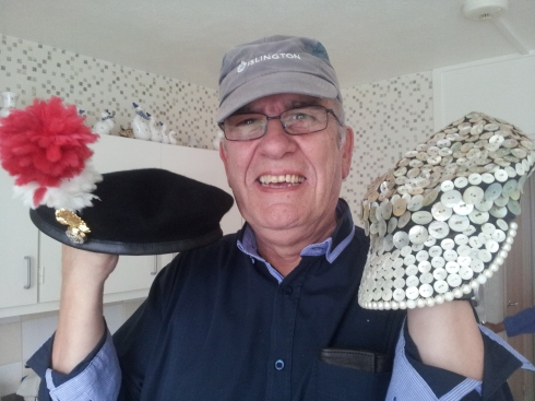 John Walters choosing which of his three hats to wear: he's caretaker at Girdlestone Estate, Archway and is proud to have worked for 42 years for Islington. He's also had a career in the Royal Regiment of Fusiliers (just like Michael Caine) and is the Pearly King of Finsbury.