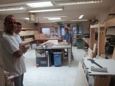 Cass Farrell with the Small Restoration joiners: (L-R) Cass Farrell, Terry Davis and Joseph Silva in the workshop.