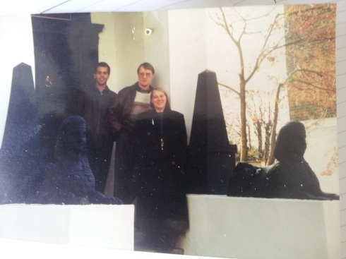 """Colin Small with his wife Jacqui and Cass Farrell pose at a house on Richmond Avenue where they'd created a grand Sphinx entrance. """"We've still got the casts at Small Restorations, they're different for the left and right,"""" says Cass."""