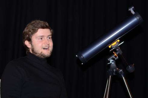 Ernestas Jegorovas with telescope. Photo by Vicky Ryzhykh.