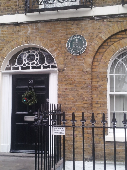 George Orwell lived in a flat on the top floor at 27b Canonbury Square. The plaque has the wrong dates.