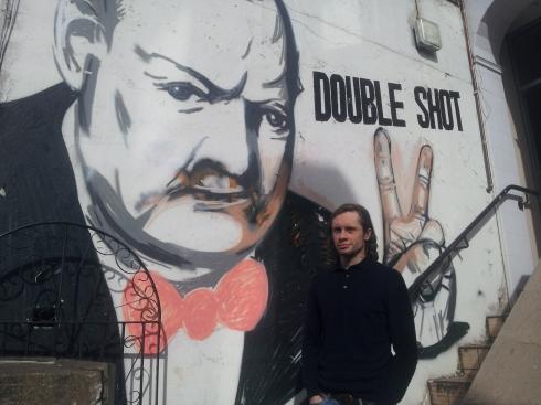 Illustrator Nick Jobbings with his version of Churchill outside Blighty, 34-36 Blackstock Road.