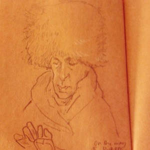 brown paper is of a woman on a bus with a big faux fur hat the type of which they wear in russia. (c) Nick Jobbings