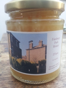 Peter Buckoke labels his bees' Finsbury Park honey with the Ambler Road elephant hedge design.