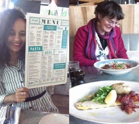 Hanisha Solomon shows off the menu. Nicola Baird (reviewing) takes notes at jamie's Italian Angel.