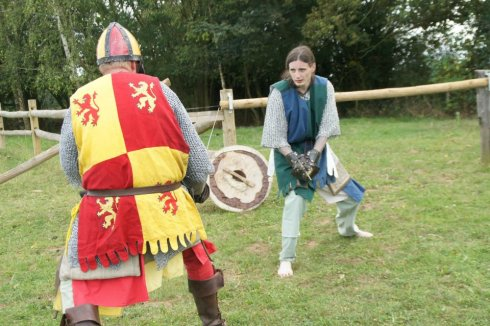 A battle with Pic simon troop leader/callum wearing a tabard over his chain mail and helmet.