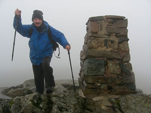 Garry Kennard at the summit of Moel Siabod, a mountain in Snowdonia. (c) Garry Kennard