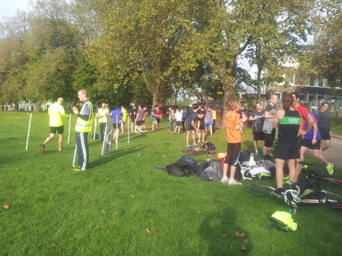 Parkrun finishers on Highbury Fields. The finishing funnel is on the left.