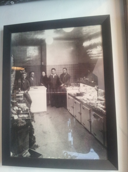 Maxence Masurier's family at their fish shop, Les Rougets de in the centre of Paris. From left to right it's his grandfather Roger, great grandfather Henri, great grandmother Natacha, employee Fernand and great uncle Pierre.