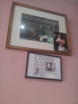A newspaper cutting showing Anna Sher meeting the Queen is on the wall at Kigi Cafe.