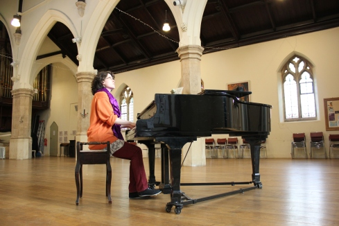 Alicia Montplaisir rehearsing on the grand piano at St Luke's West Holloway.