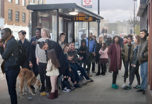 The company of Boy at an Essex Road bus stop. (c) Kwame Lestrade
